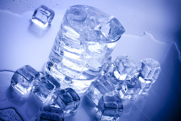 ice cubes in blue background Stock photo © BrunoWeltmann