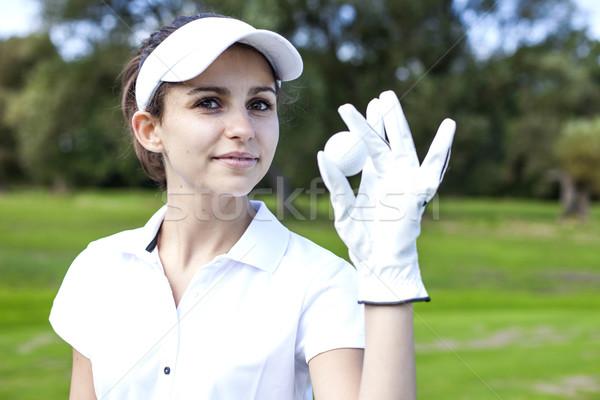 Portrait of a woman playing golf Stock photo © BrunoWeltmann