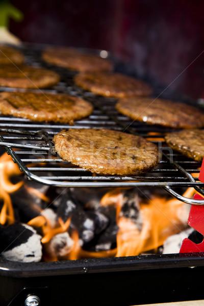 Frit viande noir cuisson flamme Photo stock © BrunoWeltmann
