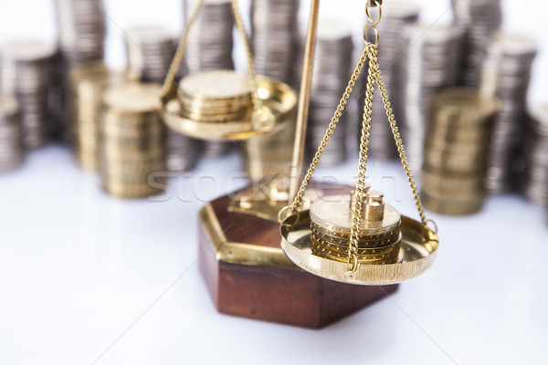 A lot of money! Coins on scales Stock photo © BrunoWeltmann