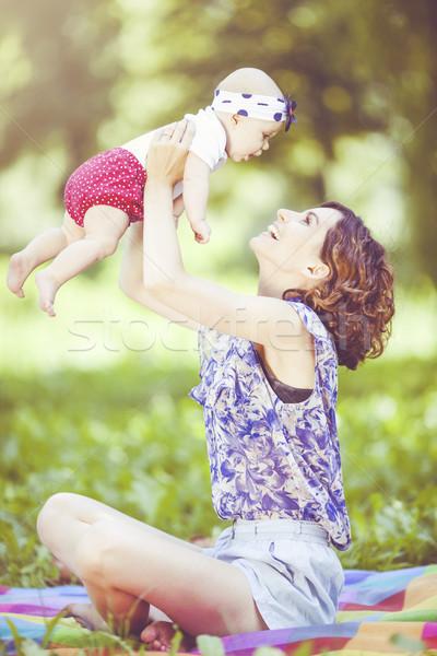 Fiatal anya játszik baba pléd park Stock fotó © BrunoWeltmann