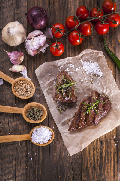 Excellent fried beef served with vegetables and spices Stock photo © BrunoWeltmann