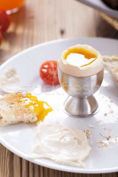 Soft-boiled egg in the morning with pepper, tomatoes and crouton Stock photo © BrunoWeltmann