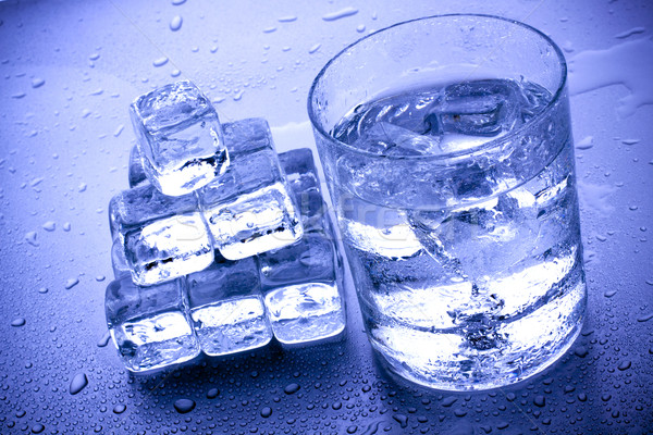 ice cubes in blue background Stock photo © BrunoWeltmann