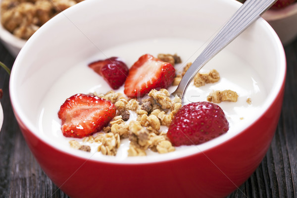 Excellent breakfast. Breakfast cereal with yoghurt and strawberr Stock photo © BrunoWeltmann