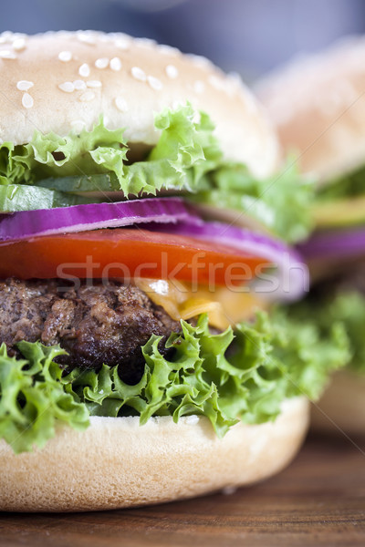 Beef burgers on a wooden board with aromatic spices Stock photo © BrunoWeltmann