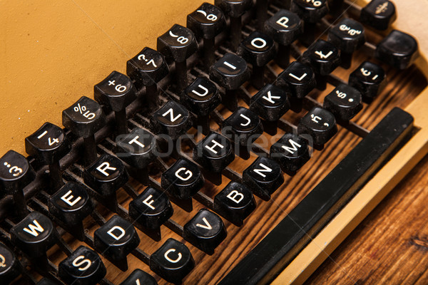 Stock photo: old typewriter, a pile of books and a lot of creativity