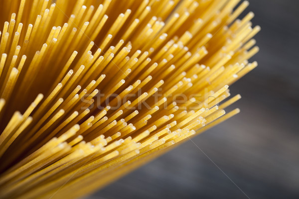 Raw Spaghetti pasta closeup Stock photo © BrunoWeltmann
