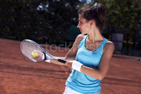 Young girl playing tennis on court Stock photo © BrunoWeltmann