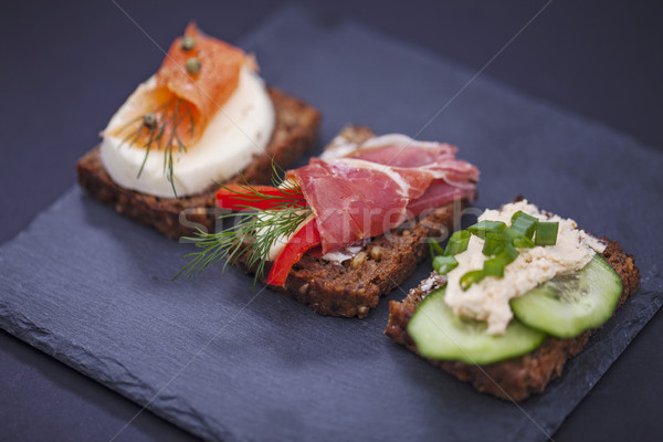 Delicious little sandwiches with tuna, cheese, prosciutto and ve Stock photo © BrunoWeltmann