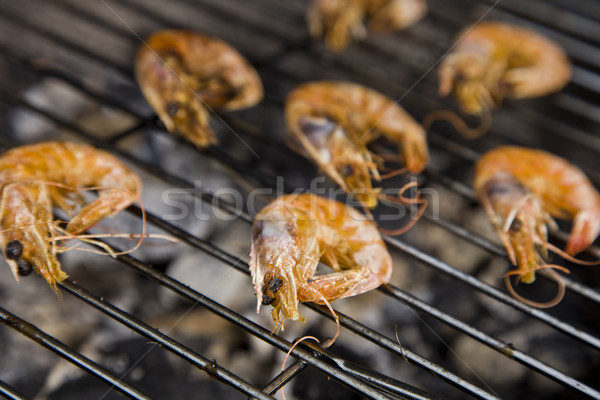 Seafood on grill Stock photo © BrunoWeltmann