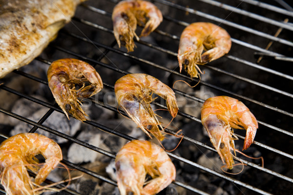 Seafood on grill Stock photo © BrunoWeltmann