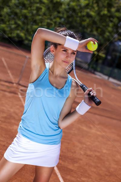 Genç kız tenis topu mahkeme kırmızı spor Stok fotoğraf © BrunoWeltmann