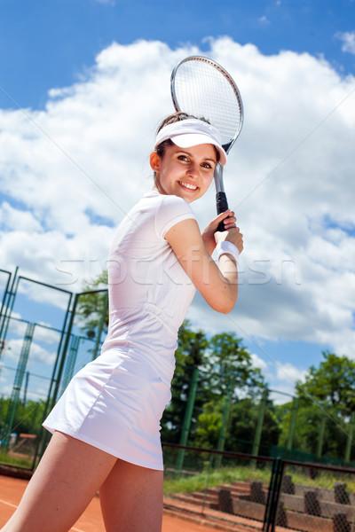 Female playing tennis Stock photo © BrunoWeltmann