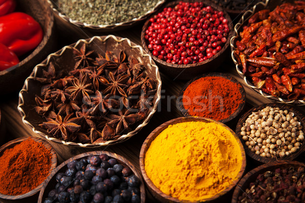 Spices and herbs in wooden bowls. Stock photo © BrunoWeltmann