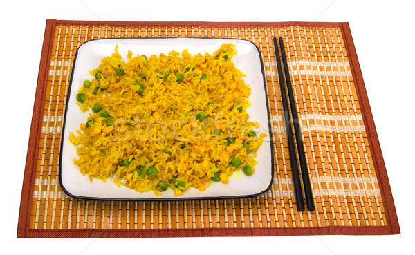 Rice with vegetables and chopsticks on bamboo mat Stock photo © BSANI