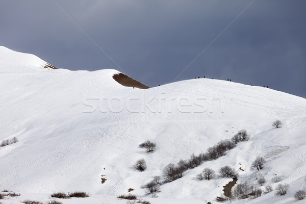 Stock photo: Off piste slope and overcast gray sky in windy day