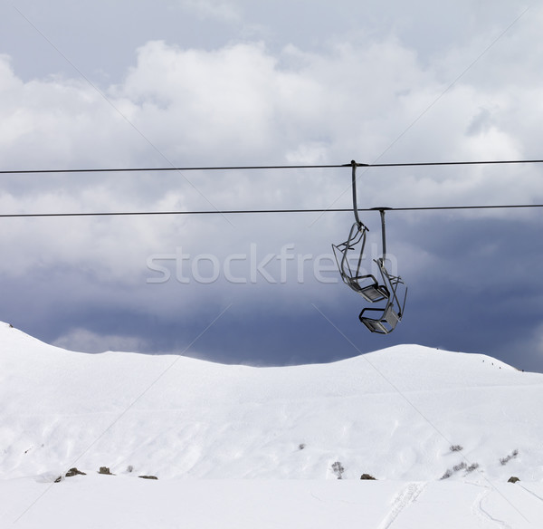 Chair lifts and off piste slope at gray day Stock photo © BSANI