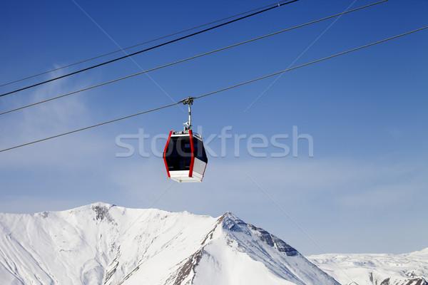 Gondola lift and snowy mountains Stock photo © BSANI