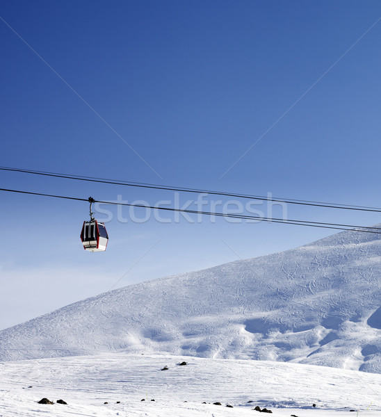 Gondola lift and ski slope at nice sun day Stock photo © BSANI