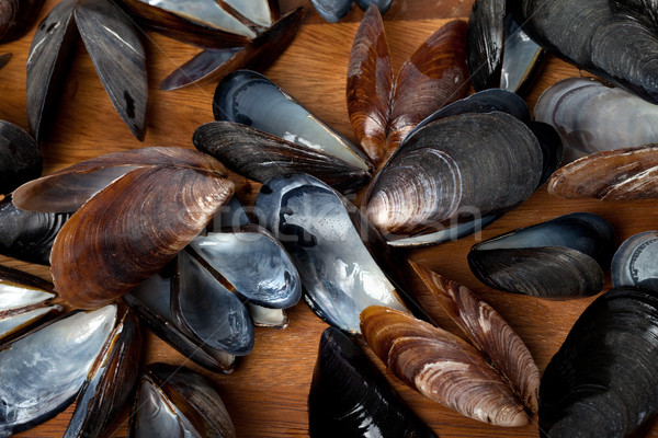 Stock photo: Shells of mussels on kitchen board