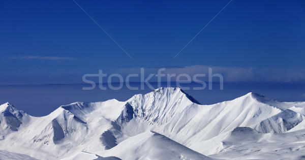 Panoramic view on off-piste snowy slope at nice sunny day Stock photo © BSANI