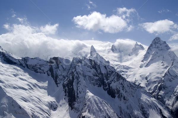 Kaukázus hegyek felhő tájkép tél kék Stock fotó © BSANI