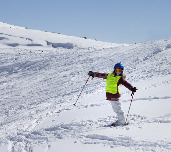 Little skier on ski slope with new fallen snow at sun day Stock photo © BSANI