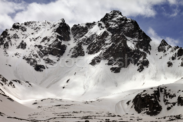 Snowy rocks with traces from avalanches Stock photo © BSANI