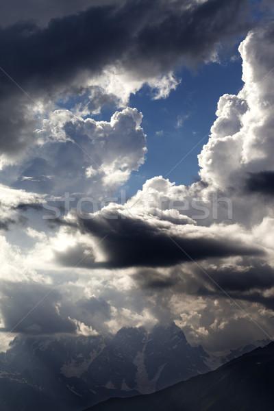 ストックフォト: 高い · 山 · 雨 · 日光 · 雲 · コーカサス