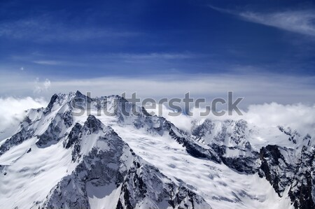 Panorama mountains in clouds. View from the ski slope. Stock photo © BSANI