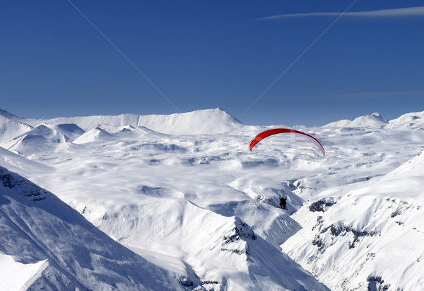 Sky gliding in snowy mountains Stock photo © BSANI
