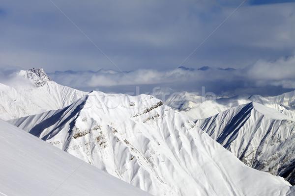 Ski slope and snowy mountains Stock photo © BSANI