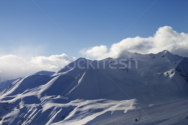 View on ski slope and sunlight mountains in evening Stock photo © BSANI