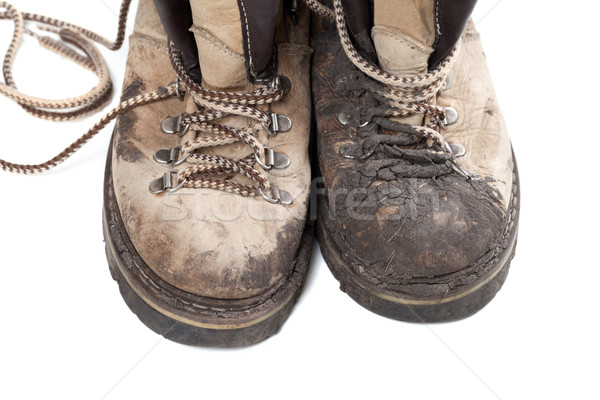 Old dirty trekking boots isolated on white background Stock photo © BSANI