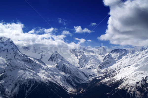 Snowy mountains at nice day Stock photo © BSANI