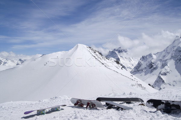 Snowboards against the top of mountain Stock photo © BSANI