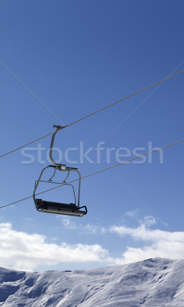 Chair lift and snowy mountains at nice day Stock photo © BSANI