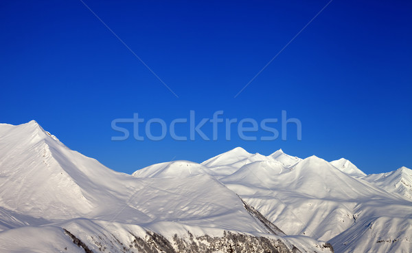Snowy mountains and blue clear sky Stock photo © BSANI