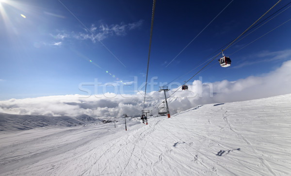 Gondola and chair lift in nice sunny day. Stock photo © BSANI