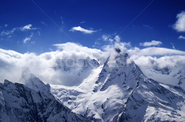 Snowy mountains in sunlight clouds Stock photo © BSANI