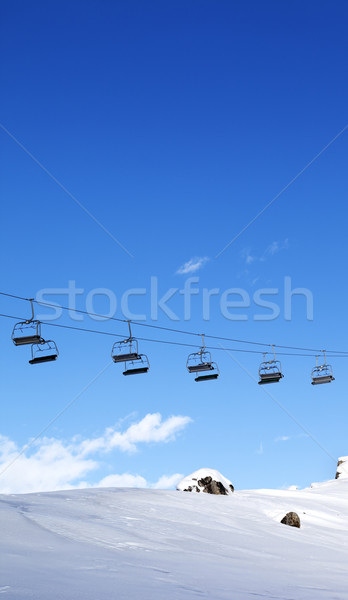 Chair-lift and blue sky at evening Stock photo © BSANI