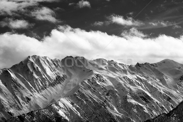 Black and white snow winter mountains and cloud sky in sun eveni Stock photo © BSANI
