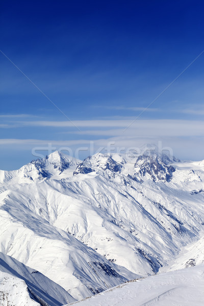 Stock photo: Sunny slopes of winter mountains