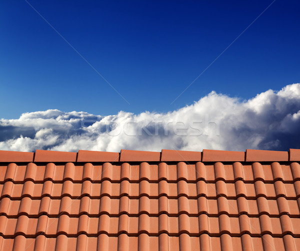 Roof tiles and sunny sky with clouds Stock photo © BSANI