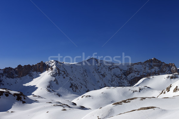 Snowy mountains and blue sky in morning Stock photo © BSANI