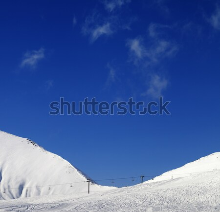 Winter snowy mountains and ski slope Stock photo © BSANI