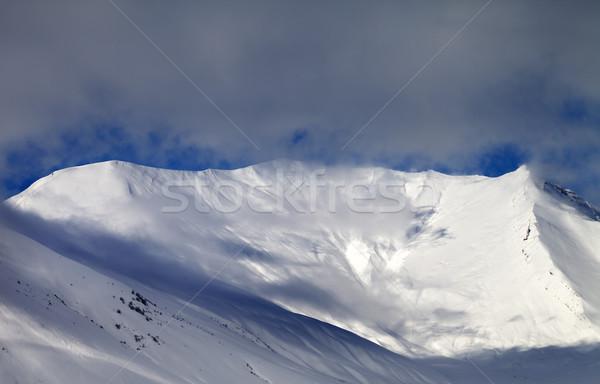 View on sunlight off-piste slope in mist Stock photo © BSANI