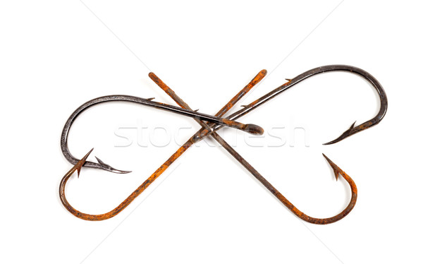 Old rusty fish hooks in form of hearts Stock photo © BSANI