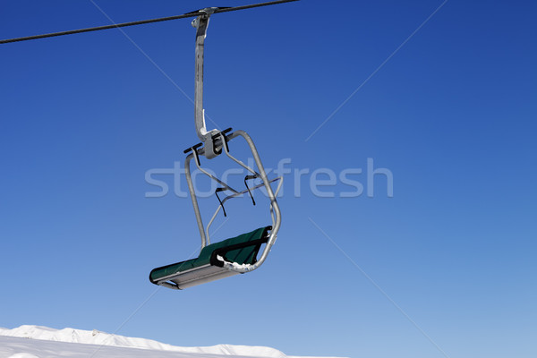 Chair-lift and blue sky Stock photo © BSANI